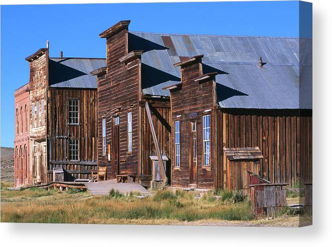 Grass Canvas Print featuring the photograph Main Street Buildings At Bodie Historic by John Elk Iii