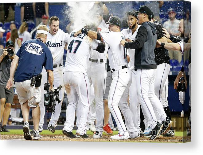 American League Baseball Canvas Print featuring the photograph Minnesota Twins V Miami Marlins by Michael Reaves