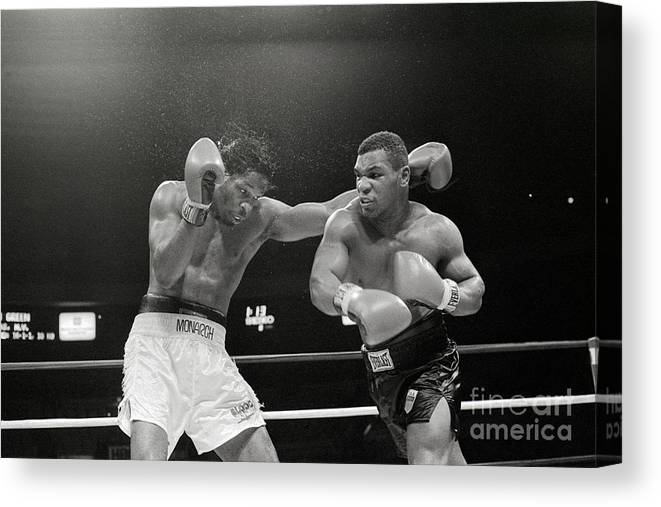 1980-1989 Canvas Print featuring the photograph Mitch Green Recoils From Mike Tysons by Bettmann