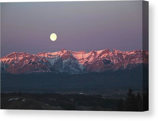 Front Range Canvas Print featuring the photograph Moon Set Over Front Range Mountains by Design Pics / Michael Interisano