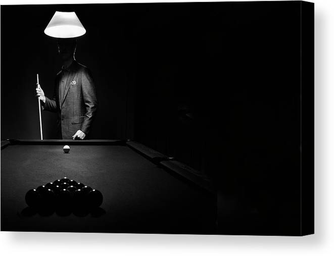 Mature Adult Canvas Print featuring the photograph Mystery Pool Player Behind Rack Of by Design Pics / Richard Wear