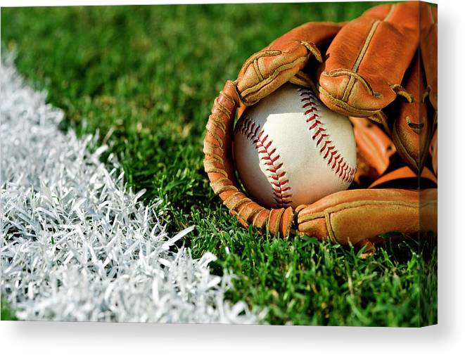 Grass Canvas Print featuring the photograph New Baseball In Glove Along Foul Line by Cmannphoto