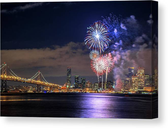 Firework Display Canvas Print featuring the photograph New Year Fireworks by Piriya Photography