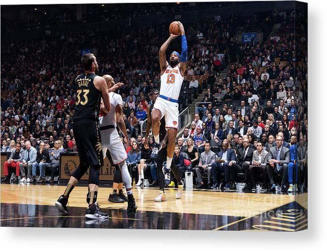 Nba Pro Basketball Canvas Print featuring the photograph New York Knicks V Toronto Raptors by Mark Blinch