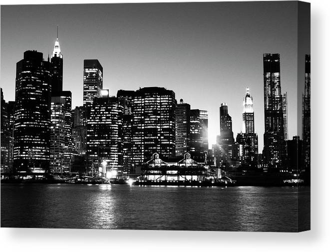Lower Manhattan Canvas Print featuring the photograph Nyc Skyline At Sunset by Lisa-blue