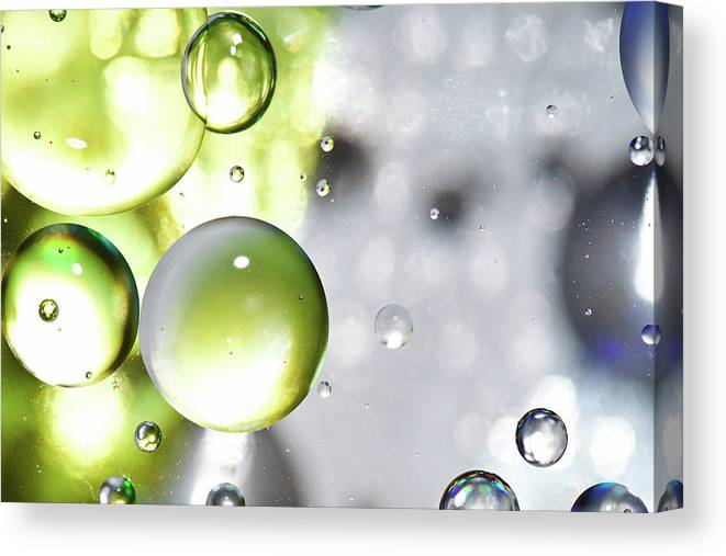 Mixing Canvas Print featuring the photograph Oil Spheres by Dovate