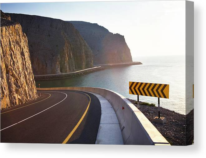 Curve Canvas Print featuring the photograph Oman, Khasab, Road Round Mountain By by Christian Adams