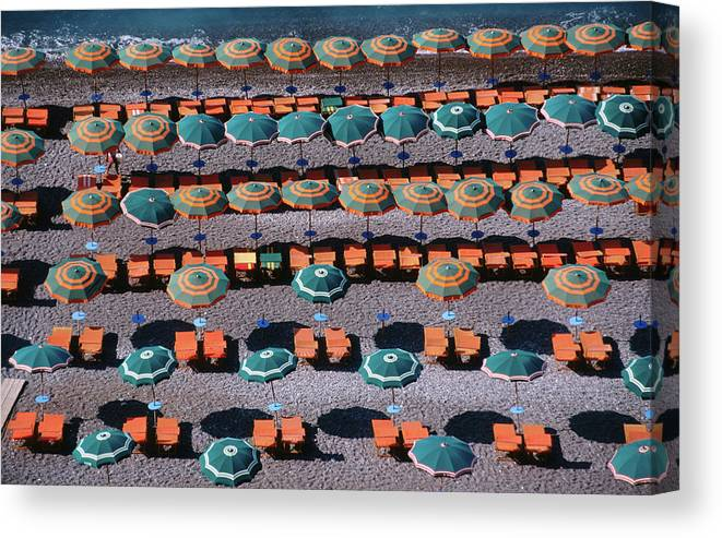 Shadow Canvas Print featuring the photograph Overhead Of Umbrellas, Deck Chairs On by Dallas Stribley