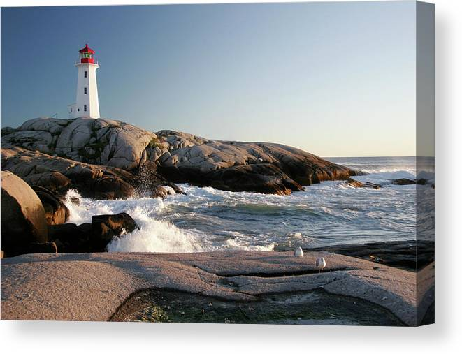 Water's Edge Canvas Print featuring the photograph Peggys Cove Lighthouse & Waves by Cworthy