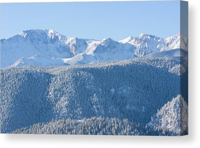 Extreme Terrain Canvas Print featuring the photograph Pikes Peak In Fresh Snow by Swkrullimaging
