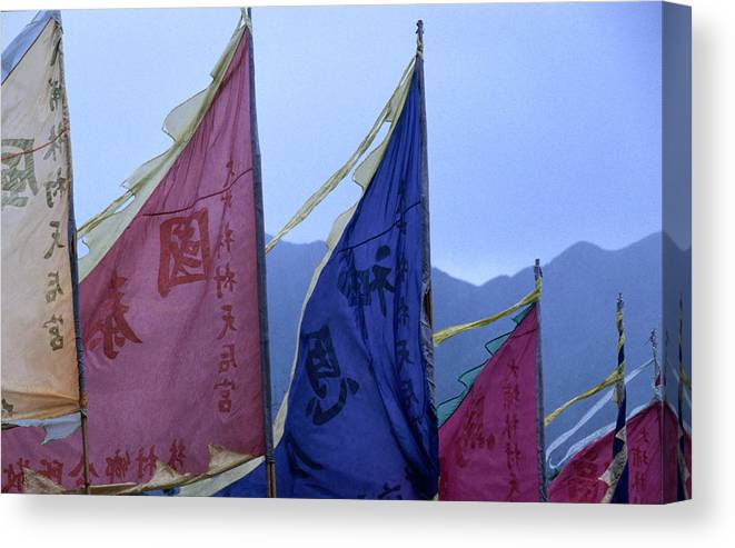 Chinese Culture Canvas Print featuring the photograph Prayer Flags To The Sea Goddess Blow In by Lonely Planet