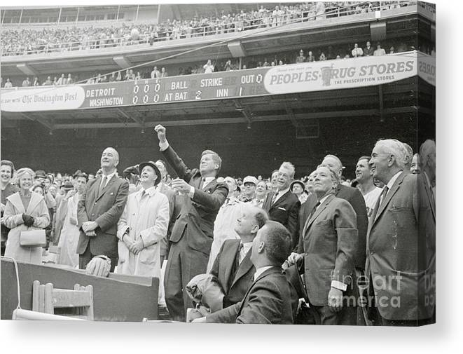 Crowd Of People Canvas Print featuring the photograph President Kennedy Tossing Out First by Bettmann