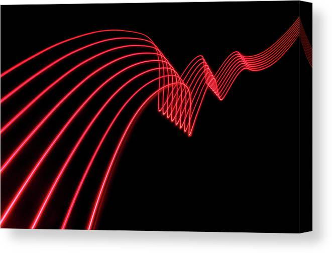 Laser Canvas Print featuring the photograph Red Abstract Coloured Lights Trails And by John Rensten
