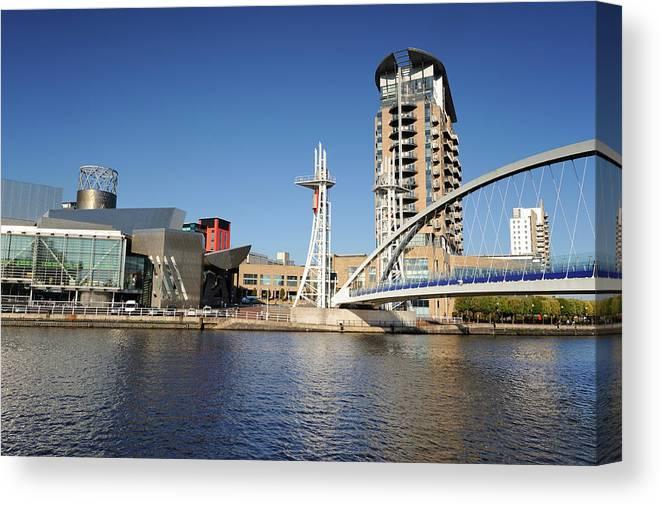 London Millennium Footbridge Canvas Print featuring the photograph Salford Quays, Manchester by Chrishepburn