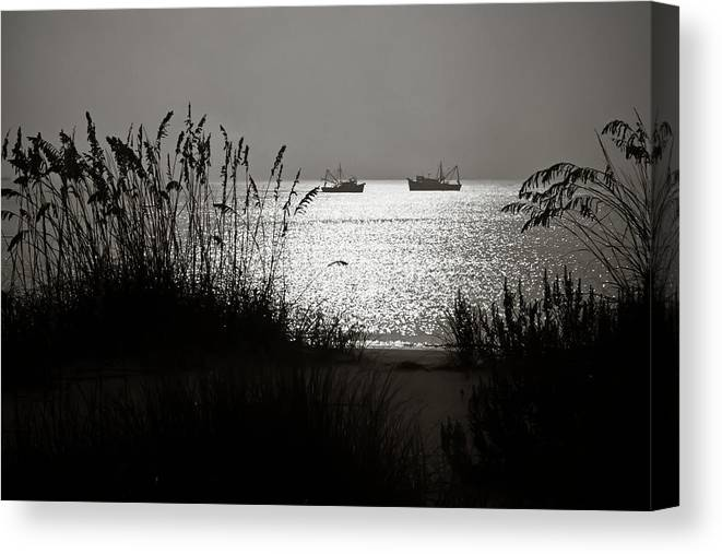 Tranquility Canvas Print featuring the photograph Silhouettes Of Sea Oats And Shrimp Boats by Joseph Shields