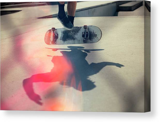 Cool Attitude Canvas Print featuring the photograph Skateboarder Doing An Ollie by Devon Strong