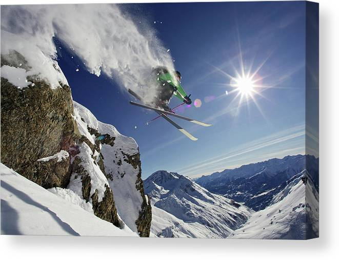 Young Men Canvas Print featuring the photograph Skier In Midair On Snowy Mountain by Michael Truelove