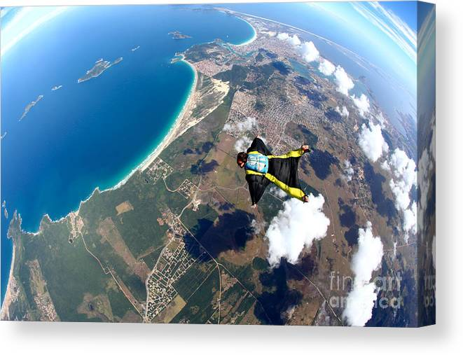 Altitude Canvas Print featuring the photograph Skydive Wing Suit Over Brazilian Beach by Rick Neves