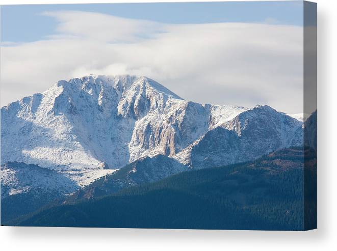 Extreme Terrain Canvas Print featuring the photograph Snowy Pikes Peak by Swkrullimaging