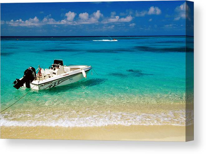Tranquility Canvas Print featuring the photograph Speedboat Moored At Conroy Beach by Richard Cummins