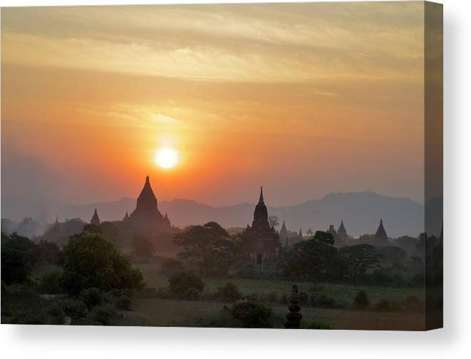 Tranquility Canvas Print featuring the photograph Sunset From Atop The Shwesandaw Paya by Jim Simmen