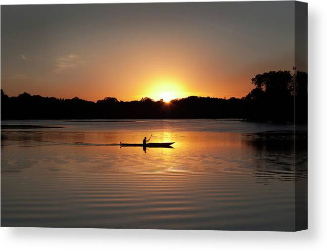 Water's Edge Canvas Print featuring the photograph Sunset Kayaking In Lake Of The Isles by Yinyang