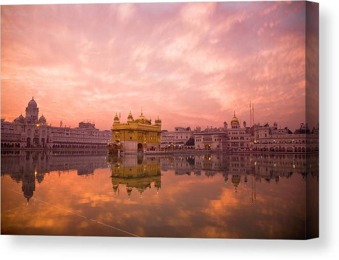 Golden Temple Canvas Print featuring the photograph Sunset Over Sikhisms Holliest by Christopher Pillitz