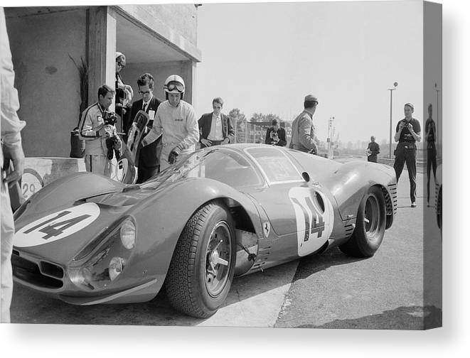 People Canvas Print featuring the photograph Surtees Tests Ferrari by Reg Lancaster
