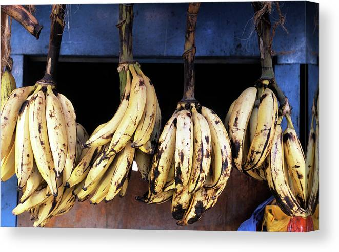 Hanging Canvas Print featuring the photograph Tanzania, Zanzibar, Bananas For Sale In by John Seaton Callahan