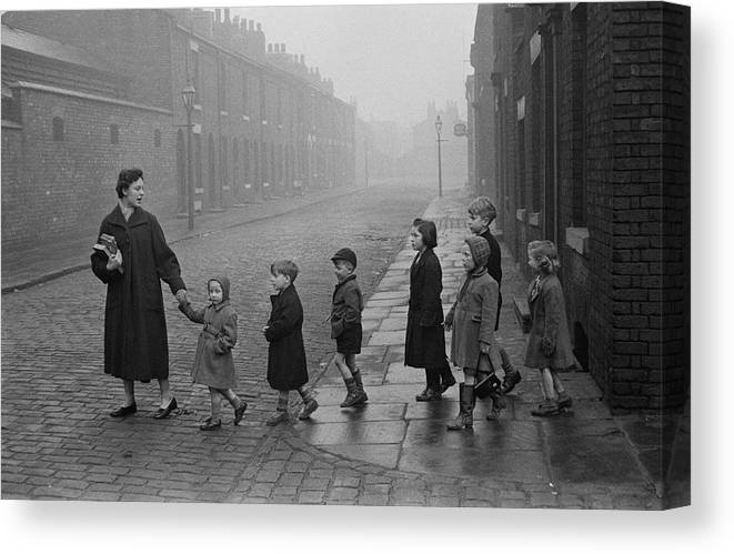 Following Canvas Print featuring the photograph Teacher And Pupils In Manchester by Bert Hardy