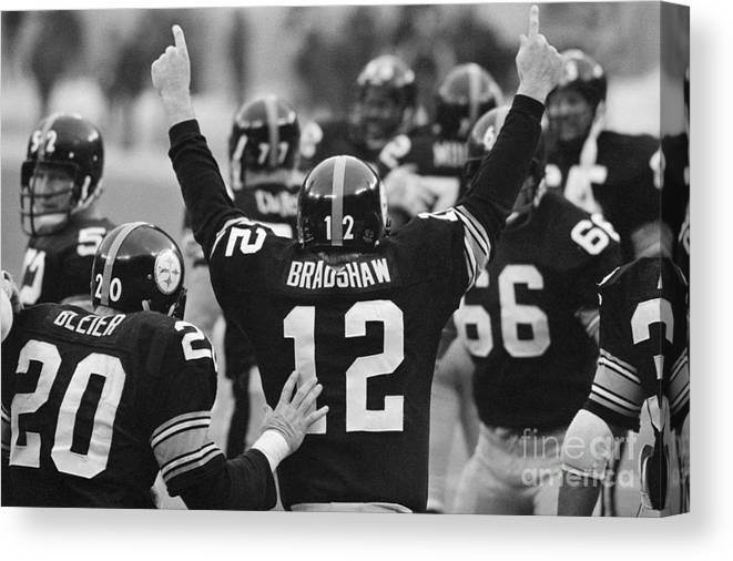 American Football Uniform Canvas Print featuring the photograph Terry Bradshaw With Arms Raised by Bettmann
