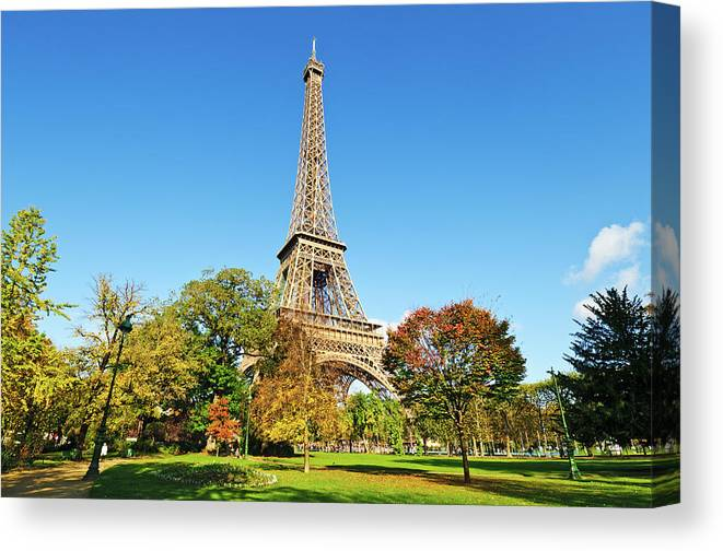 Clear Sky Canvas Print featuring the photograph The Eiffel Tower With Some Autumnal by Tom Bonaventure