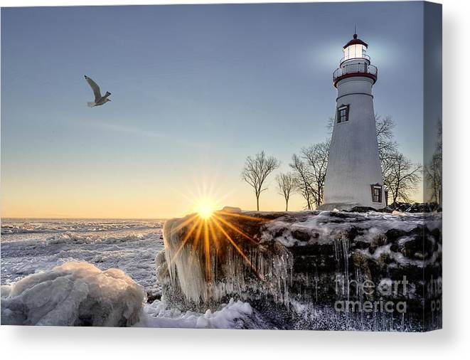 Sunrise Canvas Print featuring the photograph The Historic Marblehead Lighthouse by Michael Shake