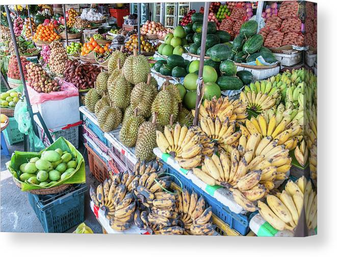 Mango Fruit Canvas Print featuring the photograph Tropical Fruit At A Street Market In by Tbradford