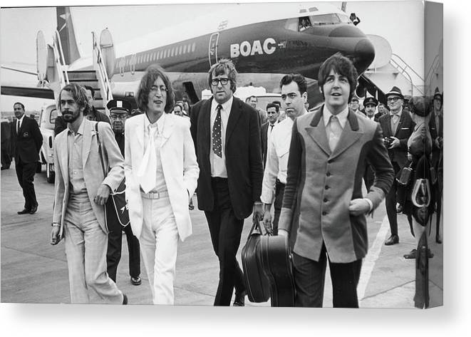 Following Canvas Print featuring the photograph Two Beatles Arrive In New York by Fred W. McDarrah