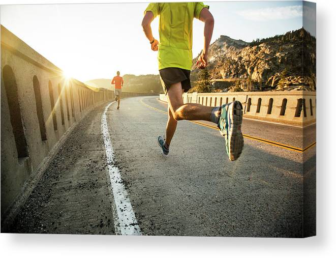 Scenics Canvas Print featuring the photograph Two Men On An Early Morning Run by Jordan Siemens