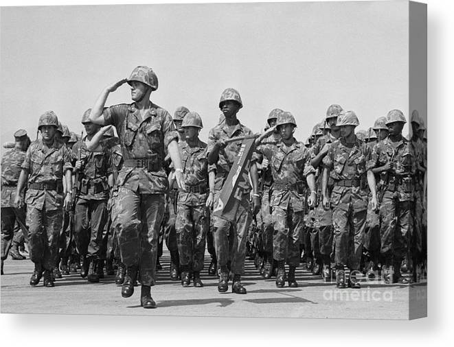 Marching Canvas Print featuring the photograph U.s. Marines Marching In Review by Bettmann