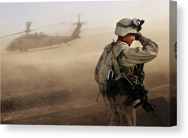 War Canvas Print featuring the photograph Us Soldiers On Special Operations In by Chris Hondros