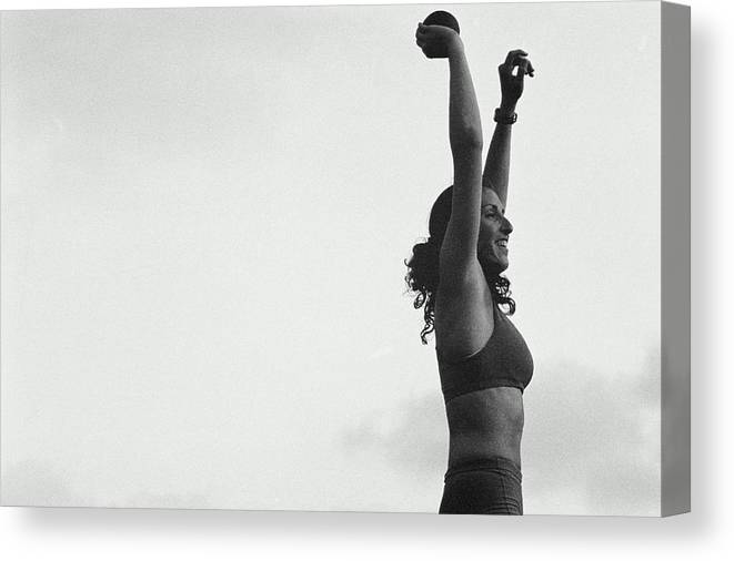 Human Arm Canvas Print featuring the photograph Woman Shot-putter With Arms In Air by Nathan Bilow