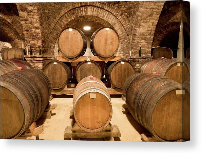 Arch Canvas Print featuring the photograph Wooden Barrels In Wine Cellar by Benedek