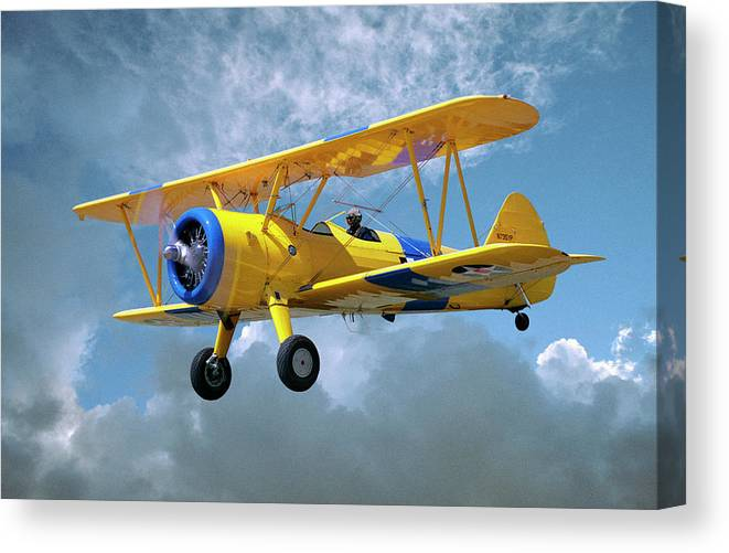 Crop Sprayer Canvas Print featuring the photograph Yellow Stearman 5yp Bi-plane Flying In by Diane Miller