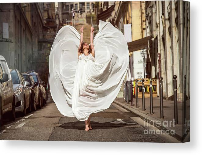 Ballet Dancer Canvas Print featuring the photograph Young Female Dancer In The Streets by Yanis Ourabah