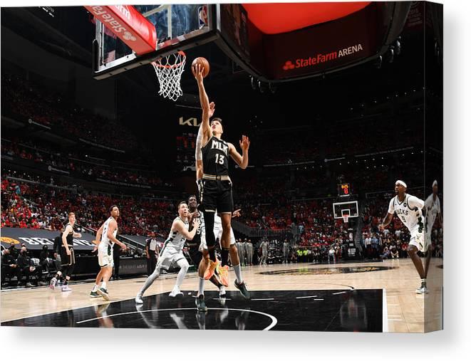 Atlanta Canvas Print featuring the photograph 2021 NBA Playoffs - Milwaukee Bucks v Atlanta Hawks by Jesse D. Garrabrant