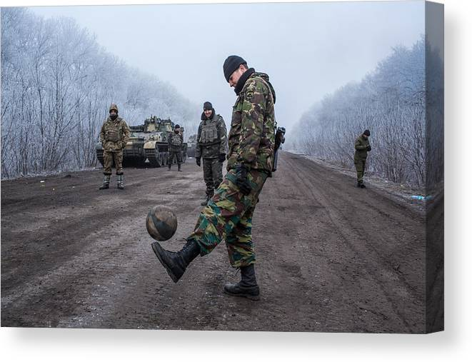 2014 Russian Military Intervention In Ukraine Canvas Print featuring the photograph A Ceasefire Is Brokered In War Torn Eastern Ukraine by Brendan Hoffman