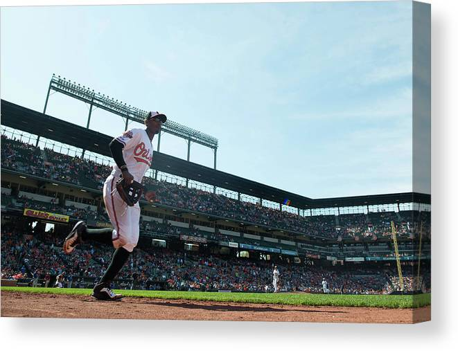 American League Baseball Canvas Print featuring the photograph Adam Jones by Rob Tringali