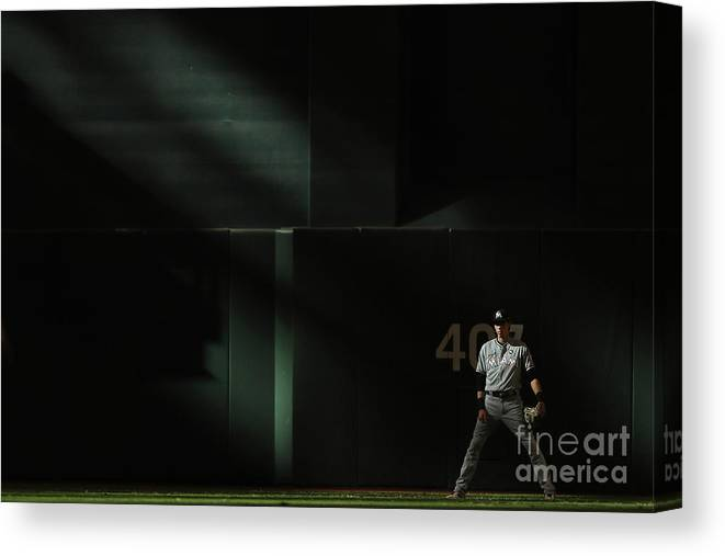 Ninth Inning Canvas Print featuring the photograph Christian Yelich by Christian Petersen