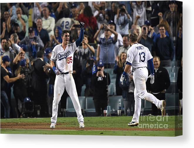 People Canvas Print featuring the photograph Cody Bellinger and Max Muncy by Kevork Djansezian