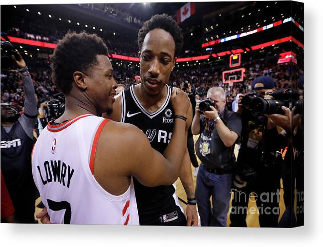 Nba Pro Basketball Canvas Print featuring the photograph Demar Derozan and Kyle Lowry by Mark Blinch