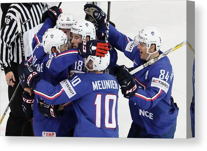 People Canvas Print featuring the photograph Finland v France - 2017 IIHF Ice Hockey World Championship by Xavier Laine