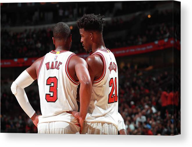 Nba Pro Basketball Canvas Print featuring the photograph Jimmy Butler and Dwyane Wade by Jeff Haynes